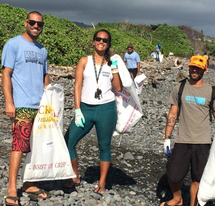 Hawaiian Paddle Sports Employees Remove Rubbish from Kaehu Beach