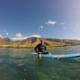 man sitting on board west maui surfing