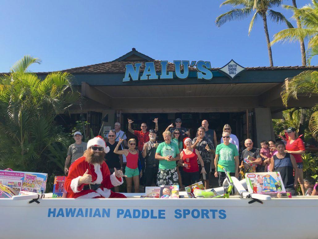 Santa in Canoe at Nalu's