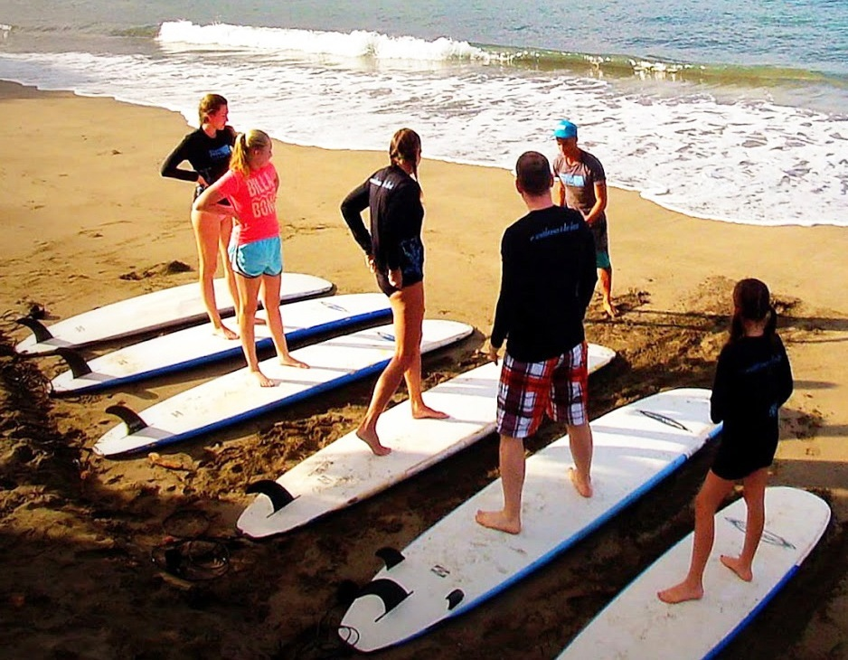 Take a surfing lesson in Maui