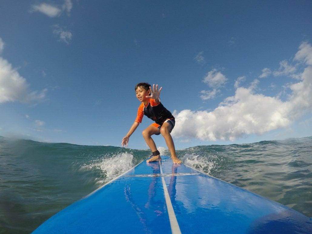 Surfing Boy Orange shirt surf