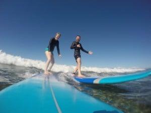 Web Surf Couple On Same Wave Smiling Copy