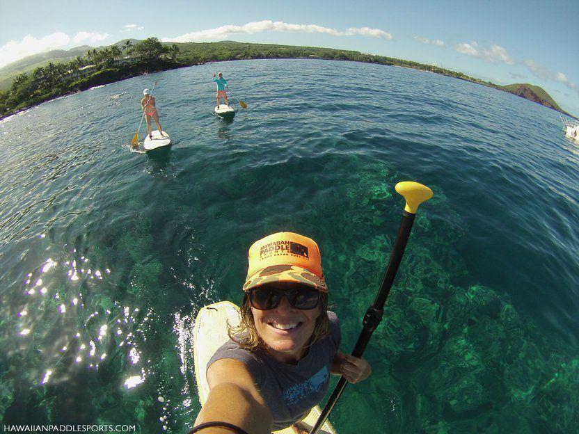 Paddleboarders along island shorelines
